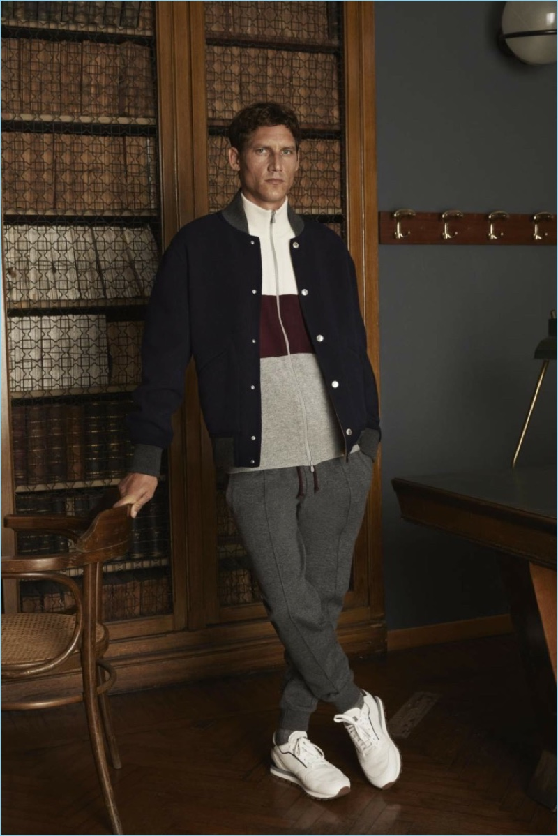 Layering for fall, Roch Barbot sports a bomber jacket, fill-zip sweater, and joggers from Brunello Cucinelli.
