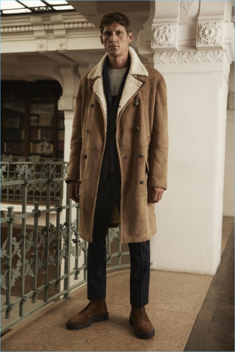 Making a style statement, Roch Barbot dons a shearling coat from Brunello Cucinelli.