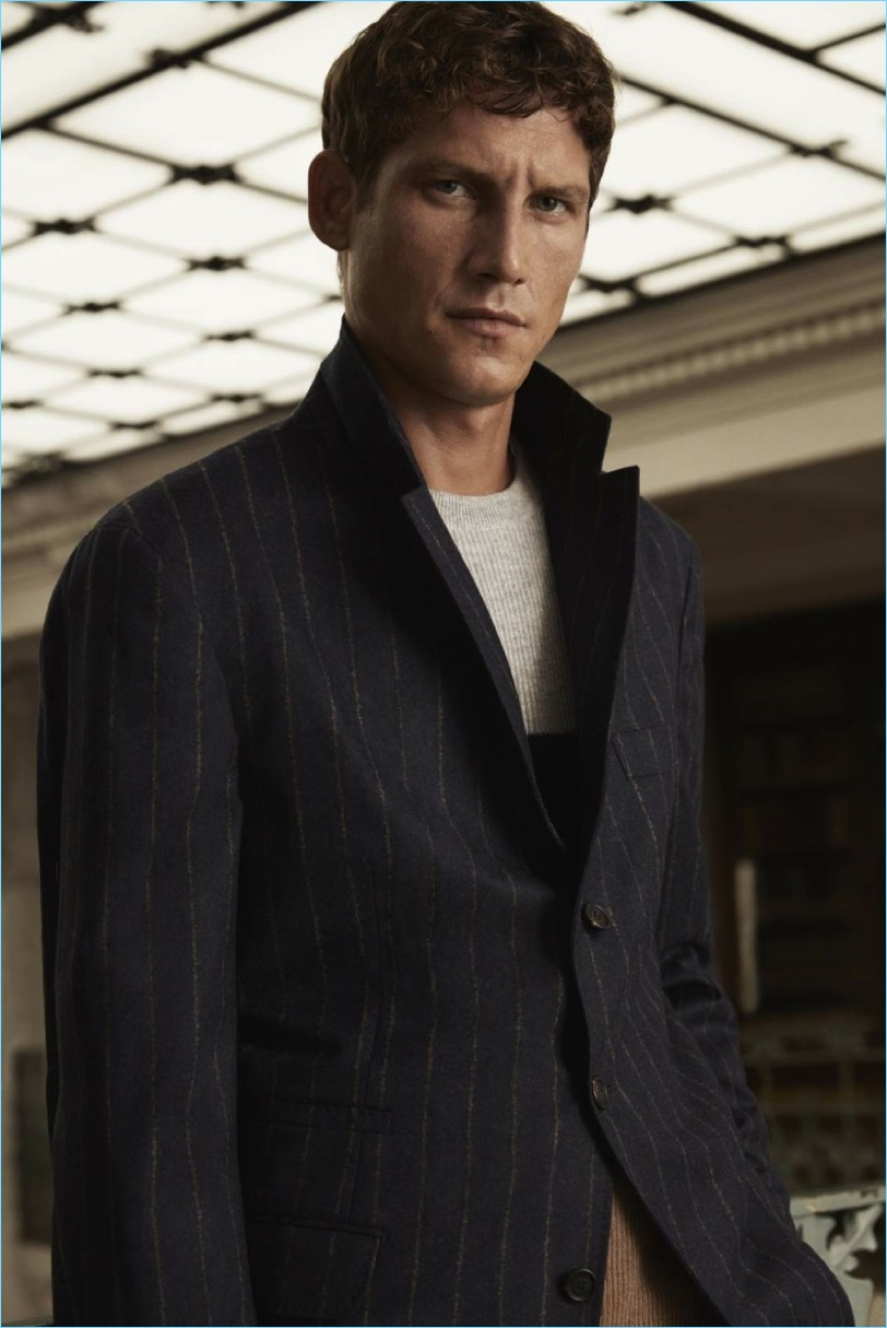 Connecting with Mr Porter, Roch Barbot wears a sleek wool suit jacket from its exclusive Brunello Cucinelli collection.