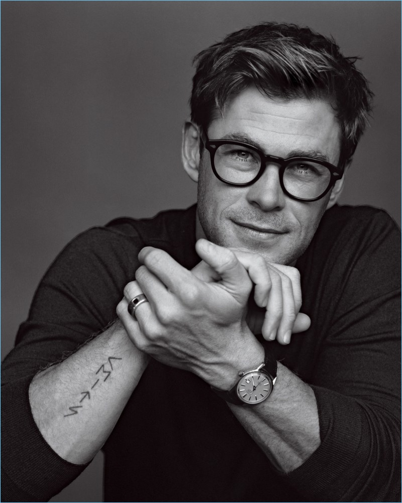 A smart vision, Chris Hemsworth dons Moscot glasses with a Gucci sweater and TAG Heuer watch.