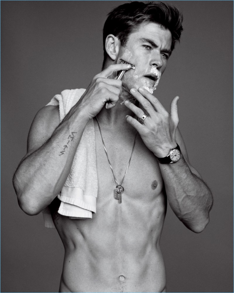 Going shirtless for the pages of GQ, Chris Hemsworth sports his own necklace and a TAG Heuer watch.