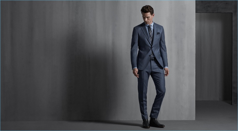 Model Guy Robinson dons a grey suit from Digel.
