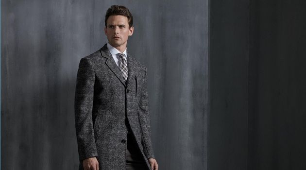 A dapper vision, Guy Robinson wears a sleek coat from Digel.