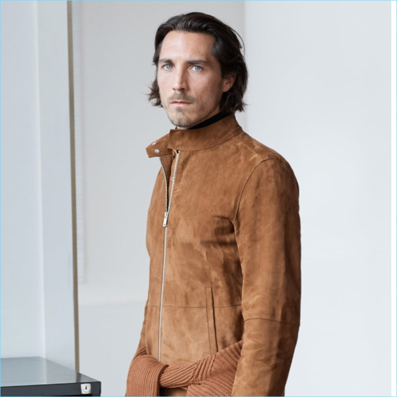 Guillaume Macé sports a brown suede jacket by Zara.