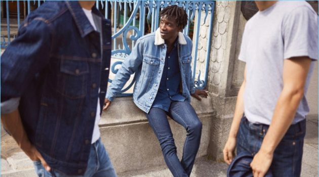 Models Ali Latif, Adonis Bosso, and Ben Allen sport denim essentials from H&M. Pictured center, Adonis dons a H&M pile-lined denim jacket, plaid oxford shirt, skinny jeans, and leather monkstrap shoes.