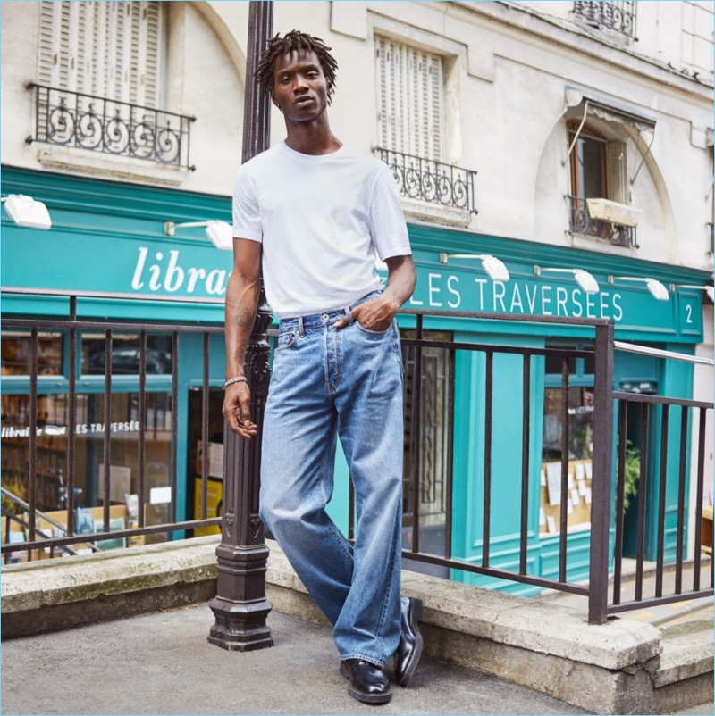 Tapping into 90s style, Adonis Bosso sports a H&M tee with baggy jeans.