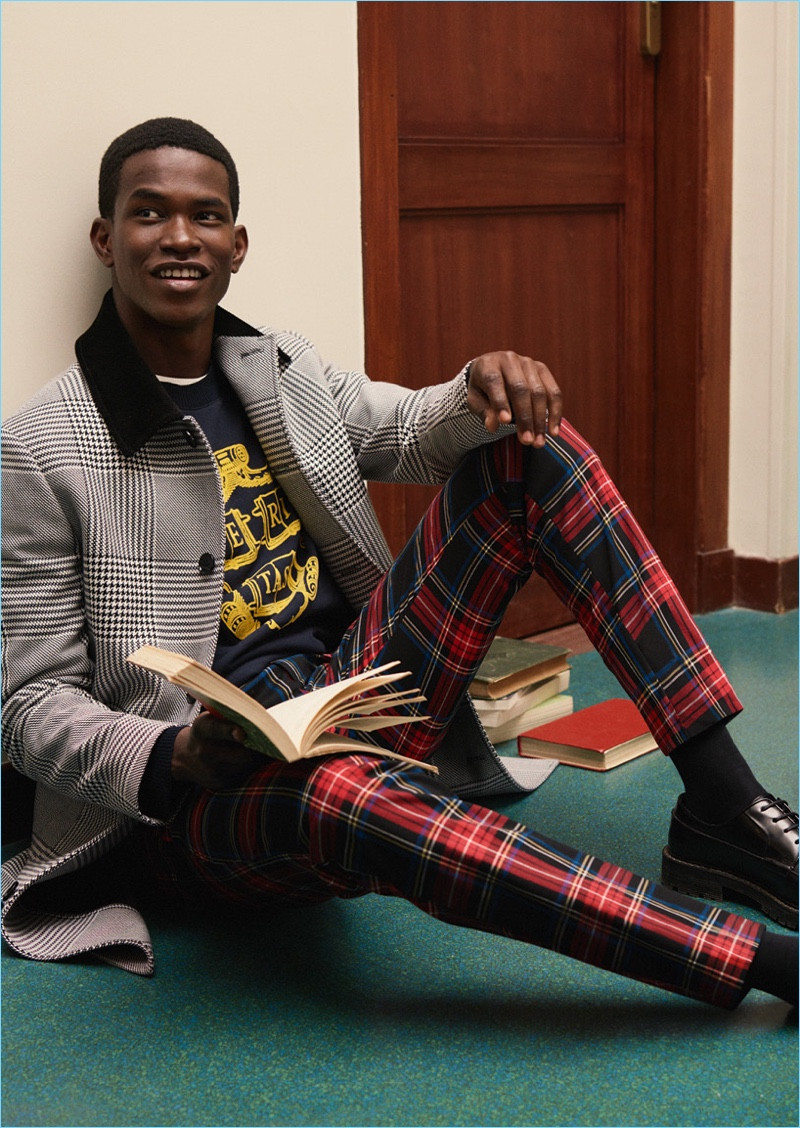 Embracing tartan, Salomon Diaz sports statement pants from H&M Studio's fall-winter 2018 men's collection.