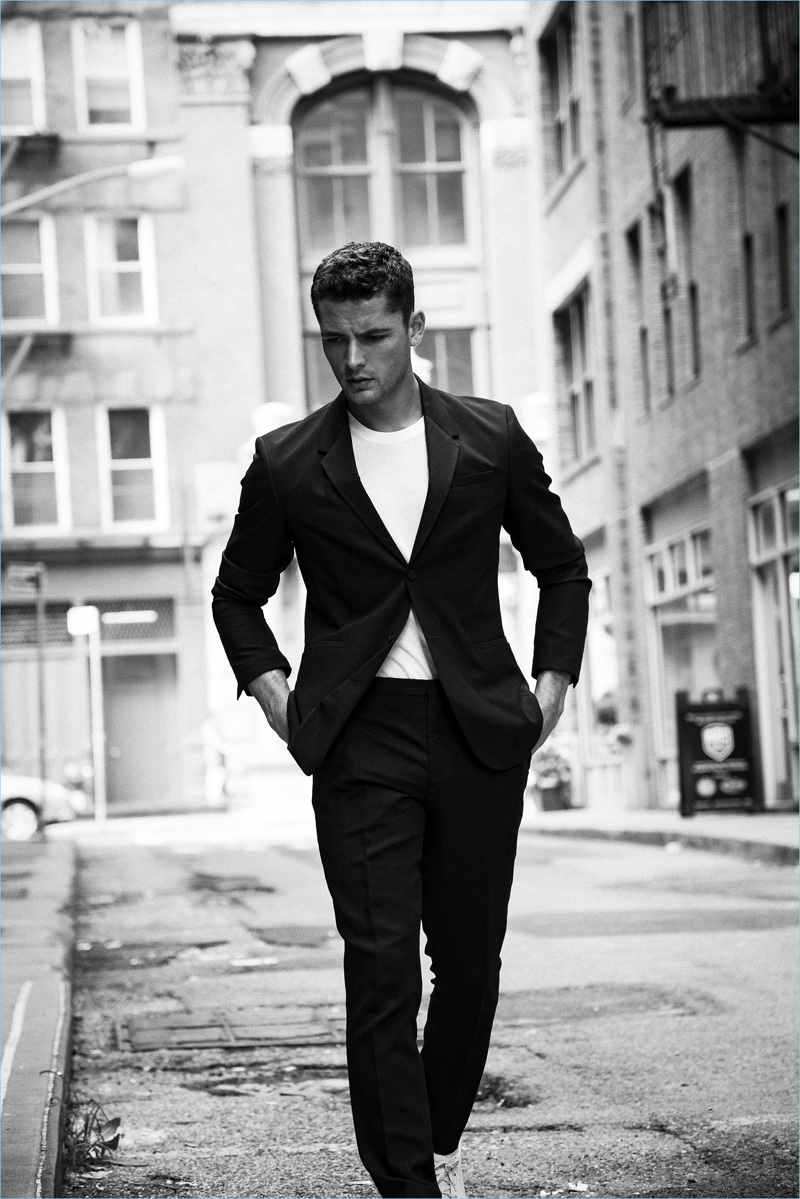 Taking to the streets of New York, Jace Moody dons a trim black suit.