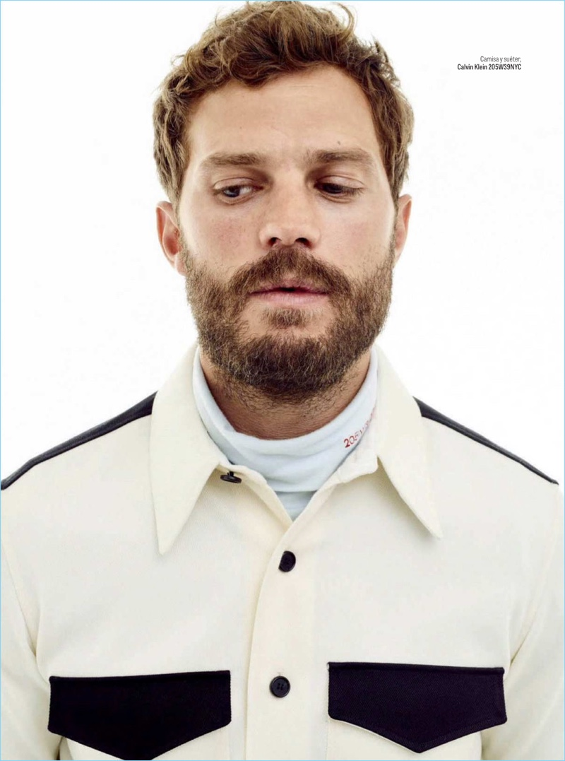 Front and center, Jamie Dornan wears a Calvin Klein shirt and turtleneck.
