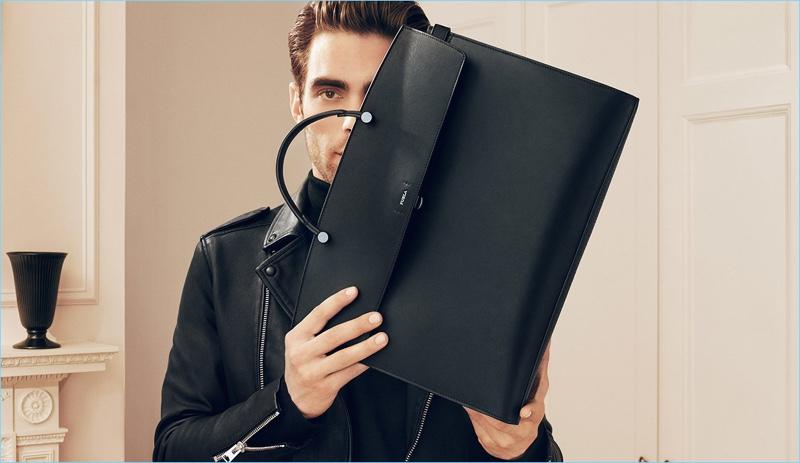 Spanish model Jon Kortajarena poses with Furla's Mercurio bag for its fall 2018 campaign.