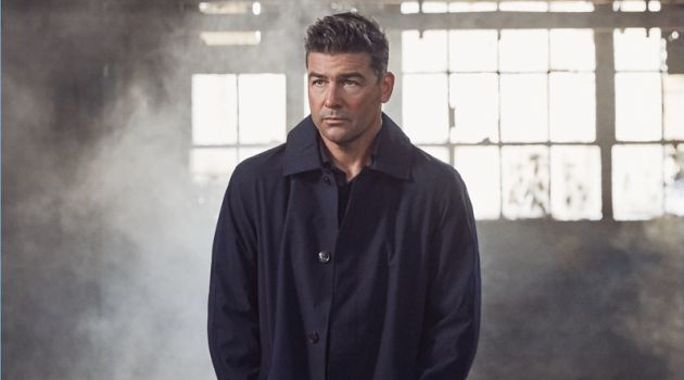 Starring in a photo shoot, Kyle Chandler wears a Michael Kors coat with a shirt nd trousers by Ermenegildo Zegna.
