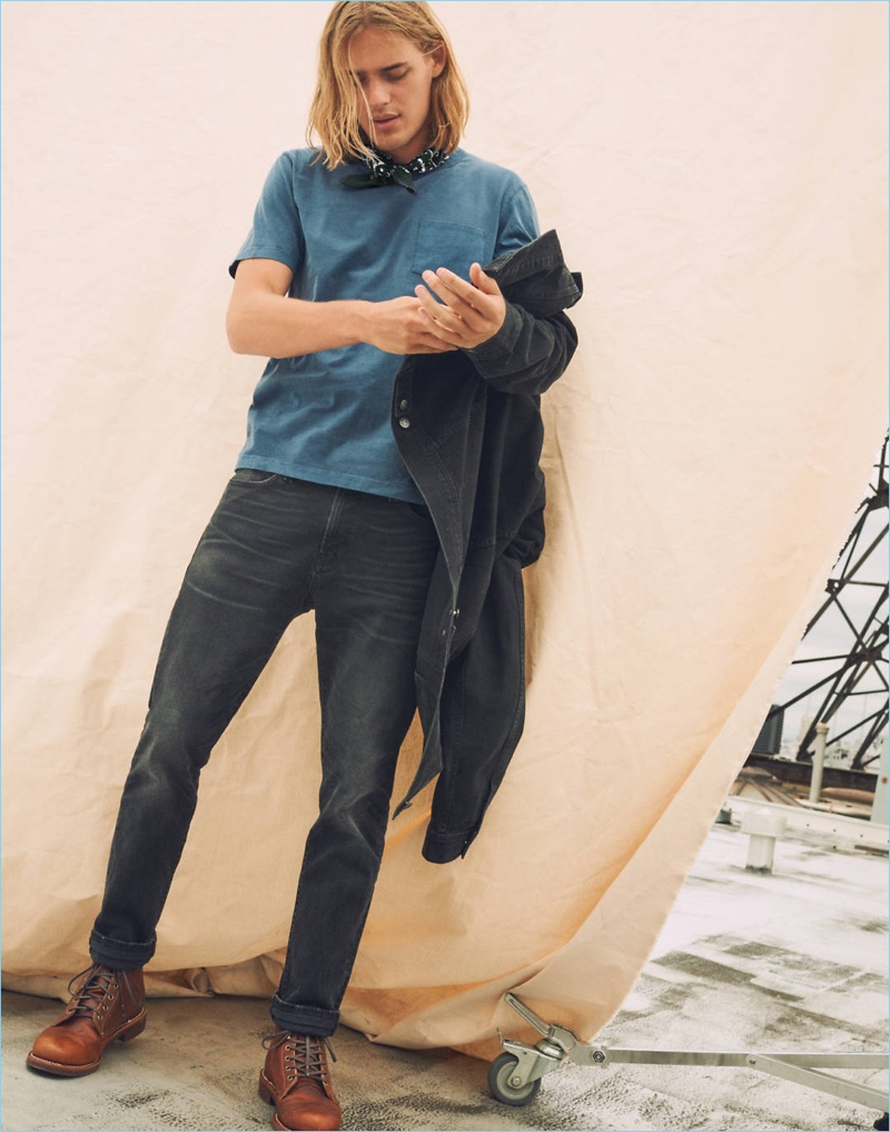 Model Ton Heukels dons Madewell's pocket tee, denim jean jacket, and slim-fit jeans.