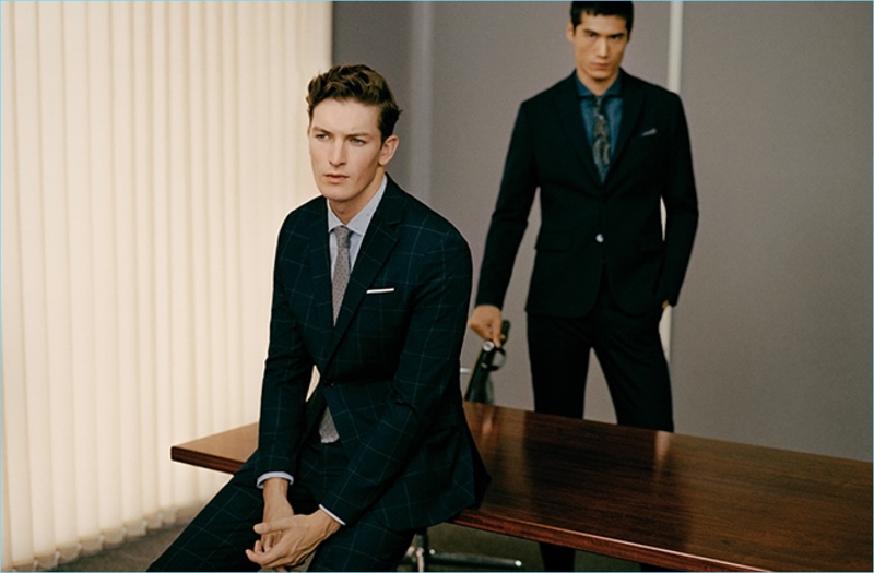 Models Oli Lacey and Hao Yun Xiang model suits for Mango Man's new guide.