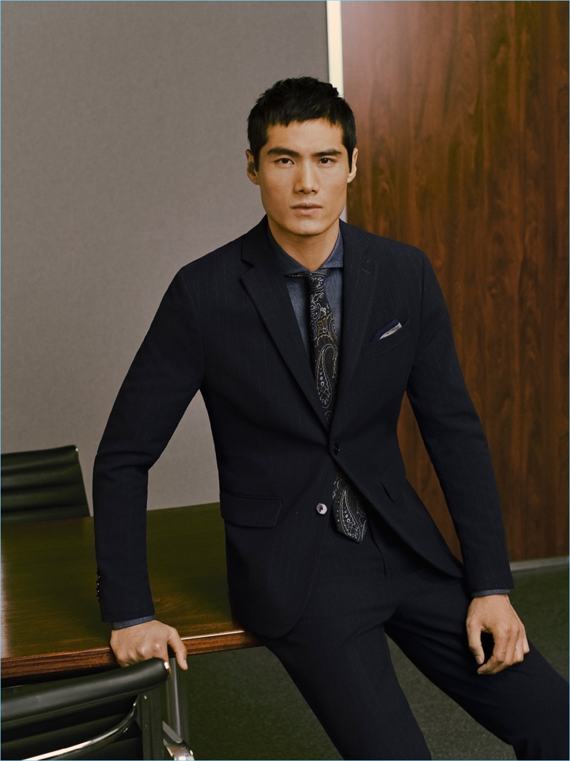 Hao Yun Xiang dons a slim-fit suit from Mango Man.