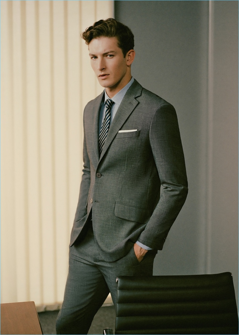 Embracing classic grey, Oli Lacey wears a suit from Mango Man.