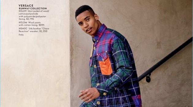 Embracing tartan, Malik Lindo wears a look from Versace.