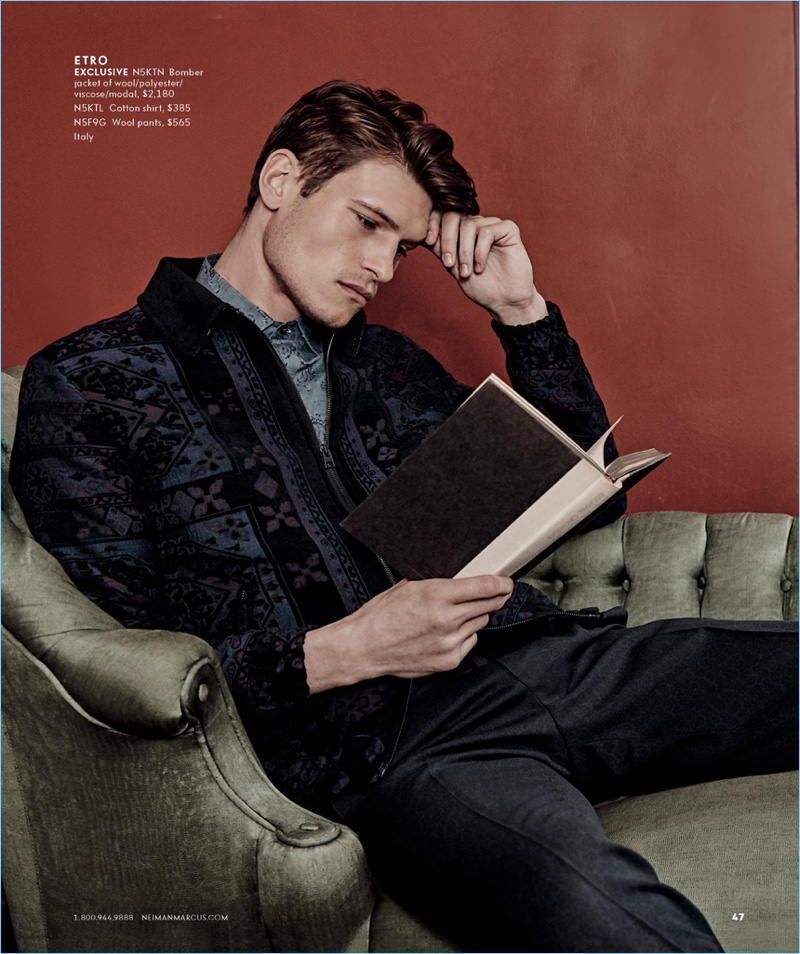 Reading a book, John Todd wears Etro for Neiman Marcus.