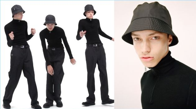 Dario Papić dons a Prada bucket hat, sneakers, wide-leg trousers, a mock-neck turtleneck, and belt.
