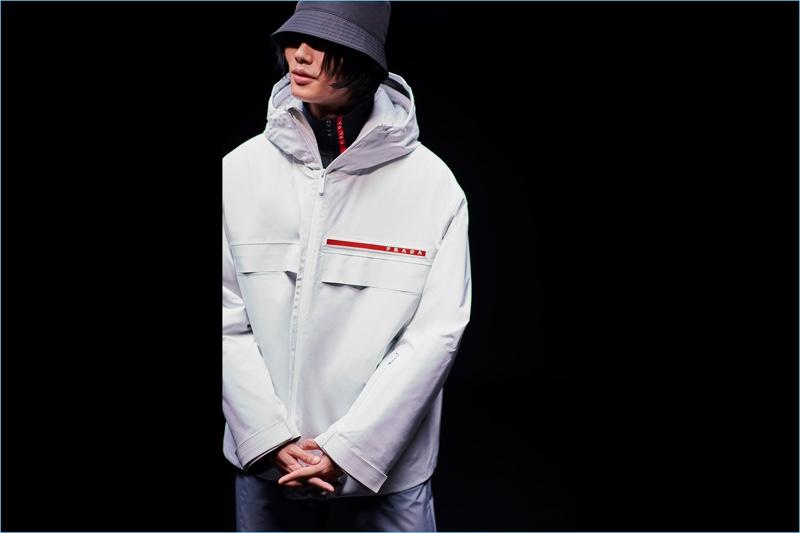 092ca6ee3c36c Model Park Taemin wears a sporty look from Prada Linea Rossa.