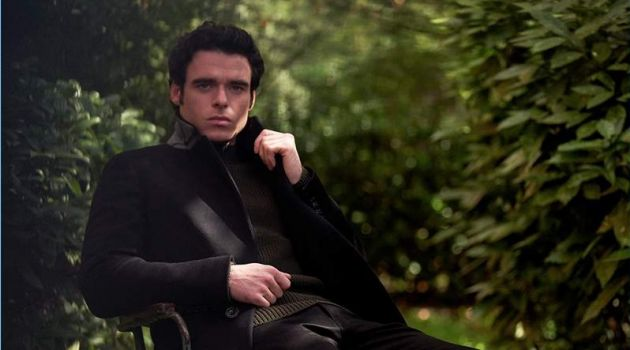 Venturing outdoors, Richard Madden sports a Burberry coat, Mr P. sweater, and Acne Studios jeans.