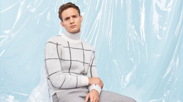 Embracing pale shades of grey, Julian Schneyder wears a look from River Island's Christmas collection.
