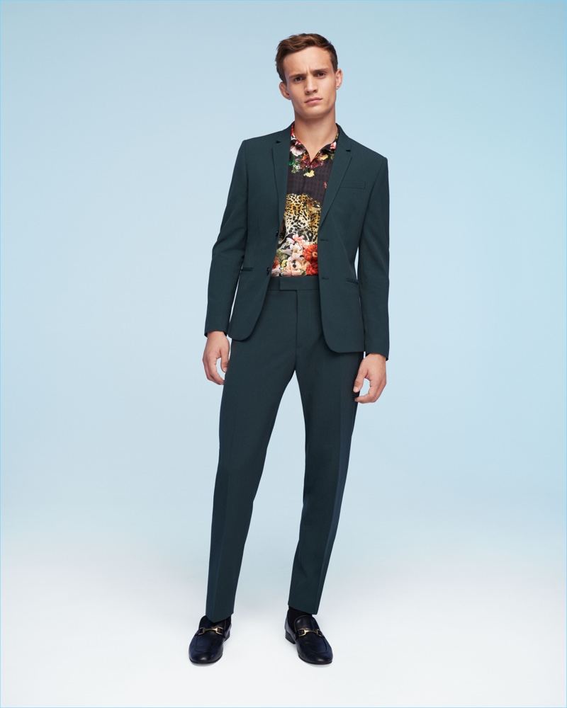 A sharp vision, Julian Schneyder dons a trim suit by River Island.