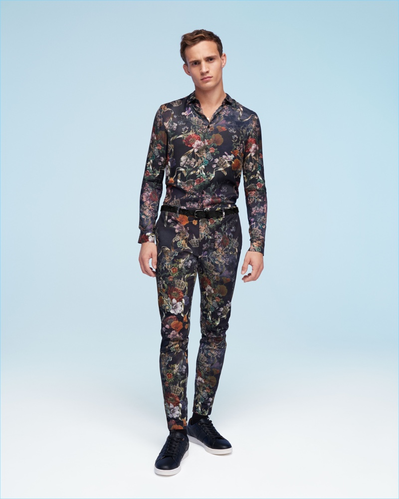 Making a case for floral prints, Julian Schneyder wears a matching shirt and trousers from River Island.