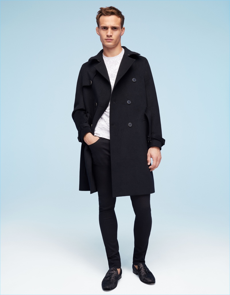 Donning a simple but smart look, Julian Schneyder connects with River Island.