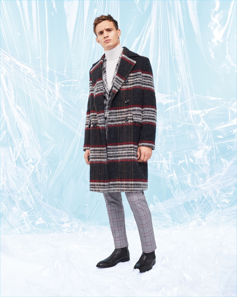 Top model Julian Schneyder dons a check coat, jacket, and pants from River Island.