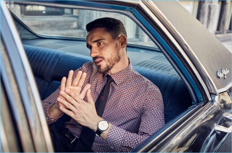 Model Arthur Kulkov sports a LE 31 geometric print shirt and embroidered tie with a Skagen watch.
