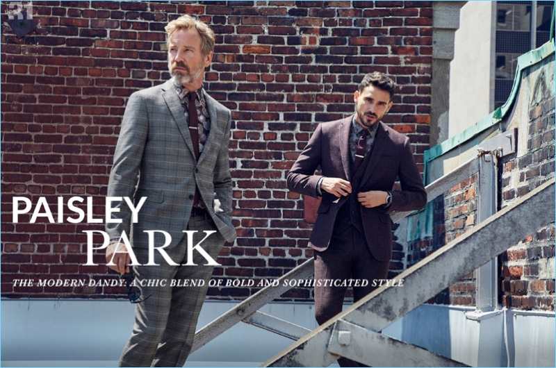 Models Rainer Andreesen and Arthur Kulkov showcase paisley print fashions from Simons. Pictured left, Rainer sports a LE 31 floral sketch shirt and colored tie with a Bosco Prince of Wales suit. Meanwhile, Arthur wears a LE 31 plum three-piece suit with a peony shirt.