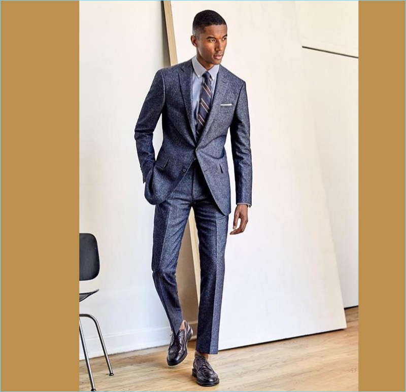 Blue Tweed Sutton Suit: Claudio Monteiro is a striking vision in a sharp tweed suit from Todd Snyder.