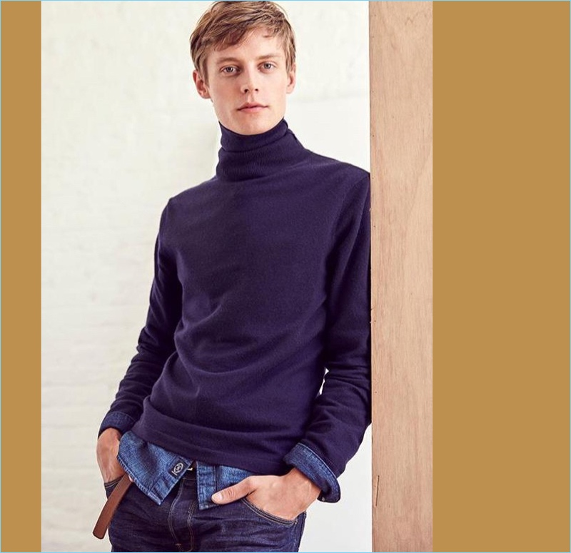 Cashmere Turtleneck: Janis Ancens dons a Todd Snyder cashmere turtleneck with a denim shirt and jeans.