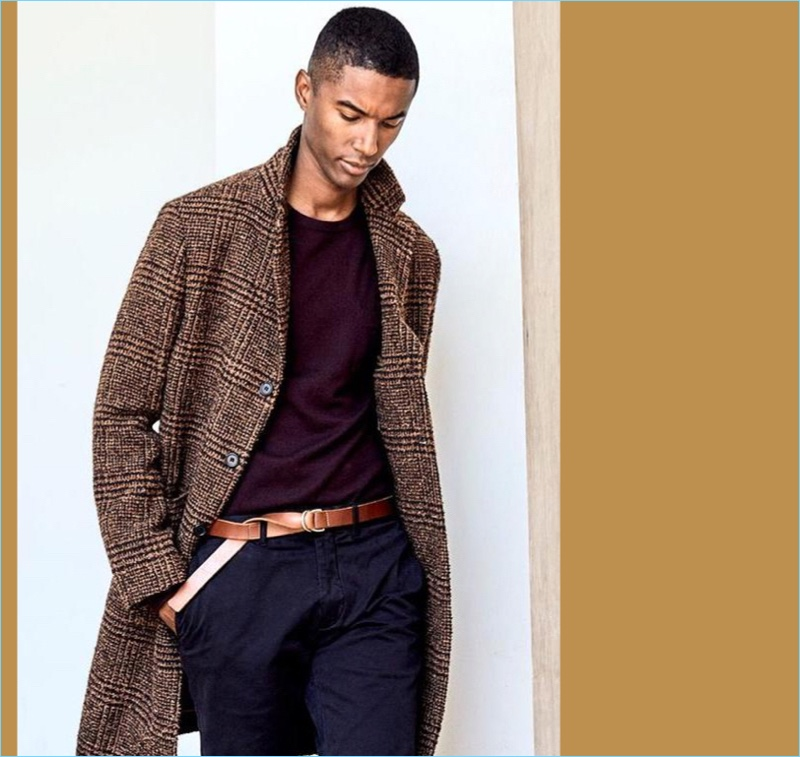 Tailored Topcoat: Claudio Monteiro is ready for the cold with a chic Todd Snyder topcoat in Italian fabric.