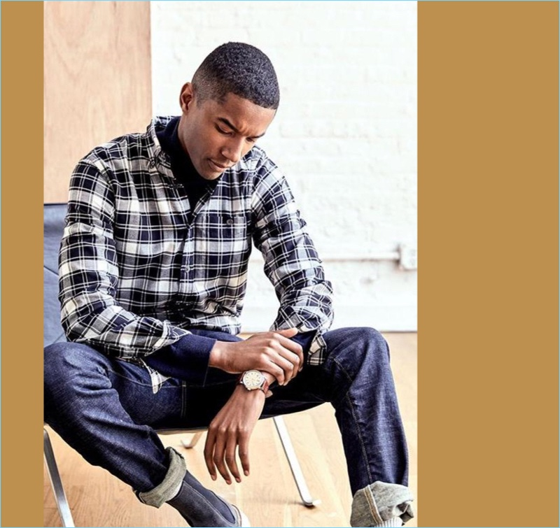 Fine Portuguese Flannel: Claudio Monteiro dons one of Todd Snyder's flannel shirts with a pair of jeans and Chelsea boots.