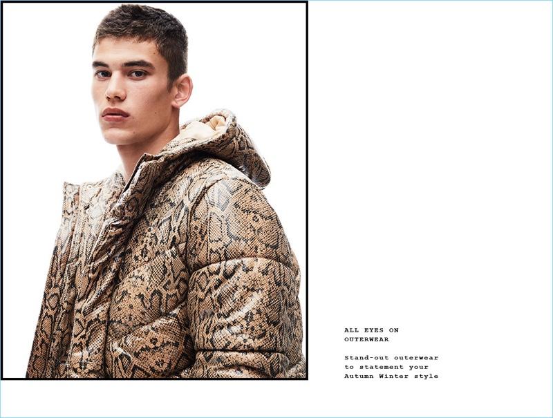 Making a statement, Finn Hayton wears a reptile print puffer jacket from Topman.