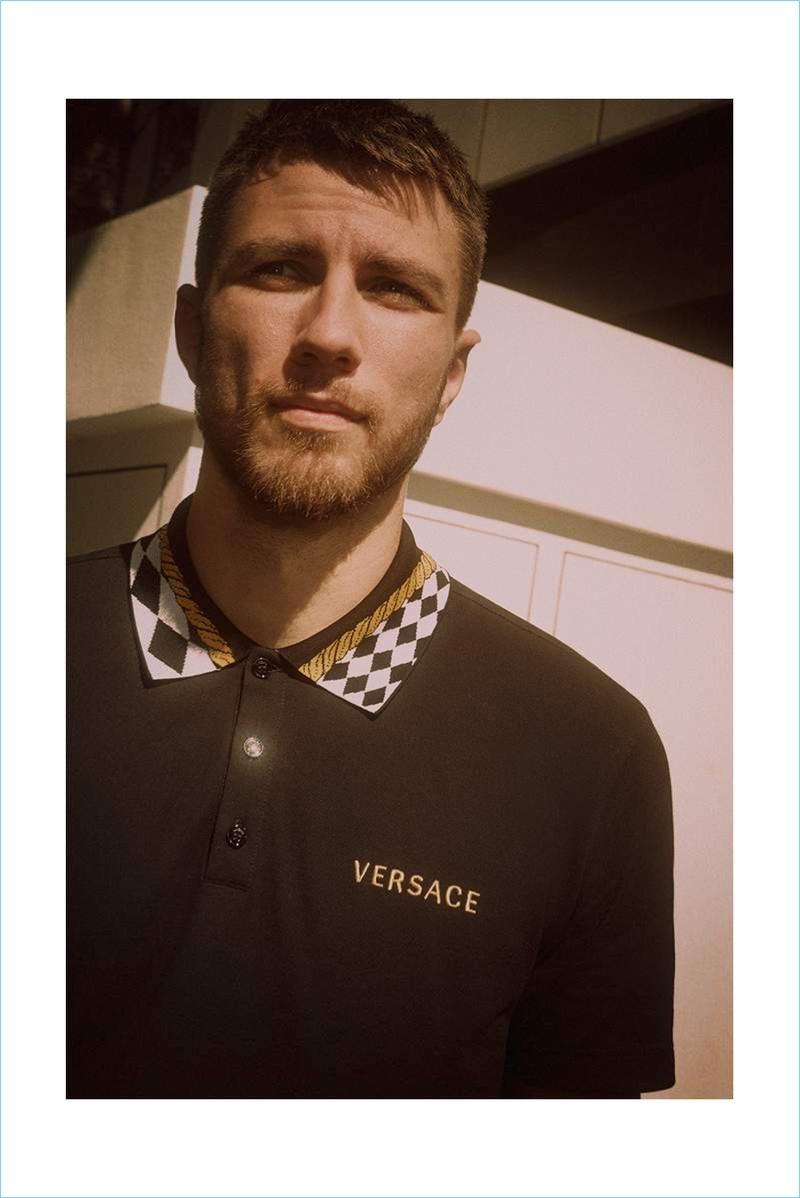 Andrew Pozzi wears a Versace cotton-piqué polo shirt.