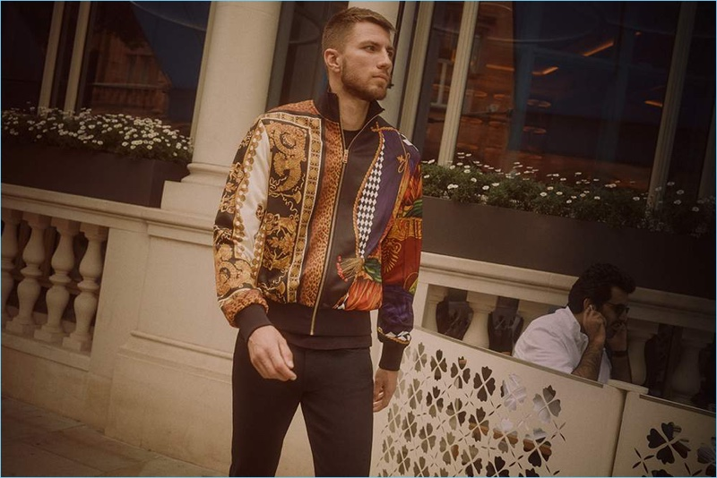 On the move, Andrew Pozzi sports Burberry jeans with a Versace t-shirt and track jacket.
