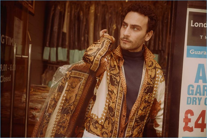 Cesare Taurasi dons a Versace track jacket, Handvaerk t-shirt, and A.P.C. white denim jeans.