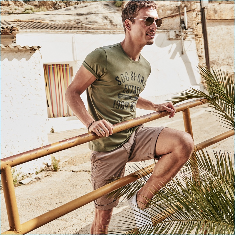 Embracing summer style, Alexandre Cunha stars in a s.Oliver campaign.
