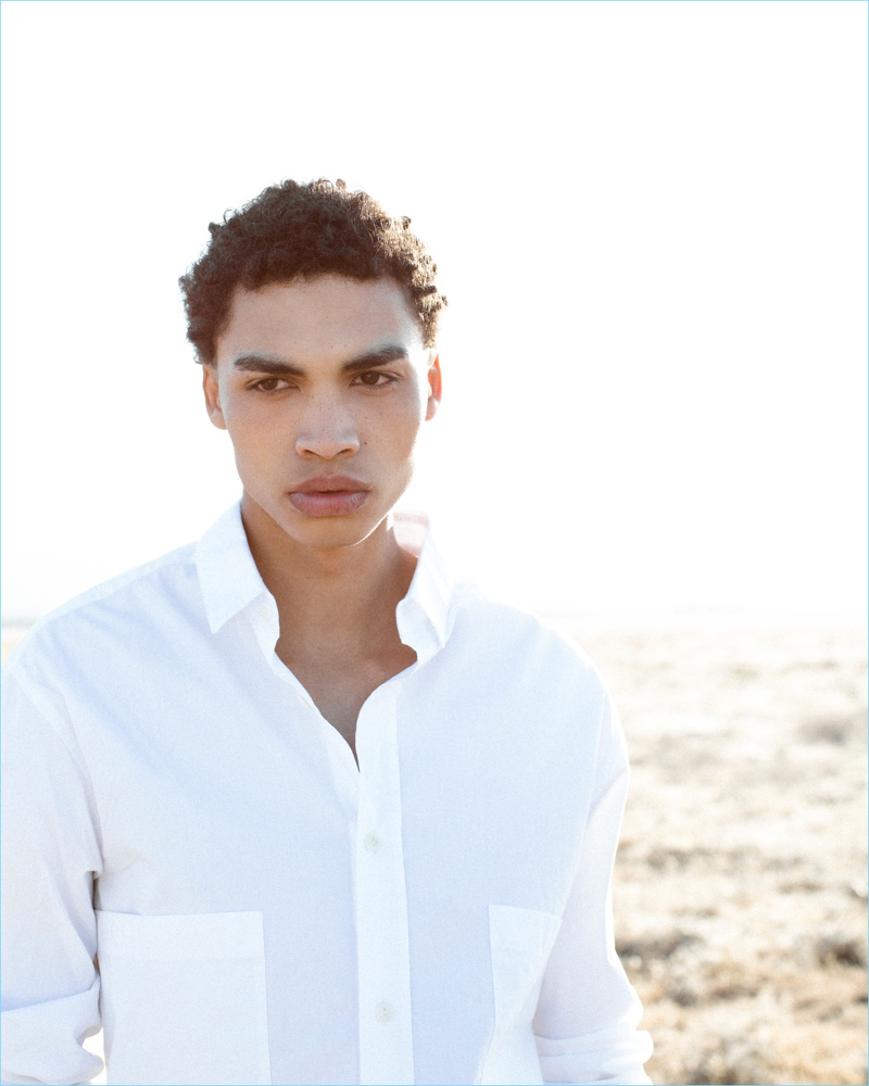Donning a white shirt, Sol Goss appears in AG Jeans' fall-winter 2018 campaign.