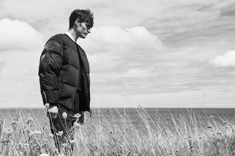 Sporting a puffer jacket, Alexander Beck wears Hugo Boss.