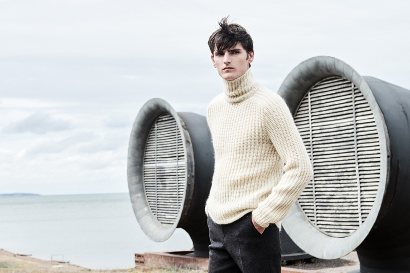A chic vision, Alexander Beck dons a turtleneck sweater with trousers from Hugo Boss.