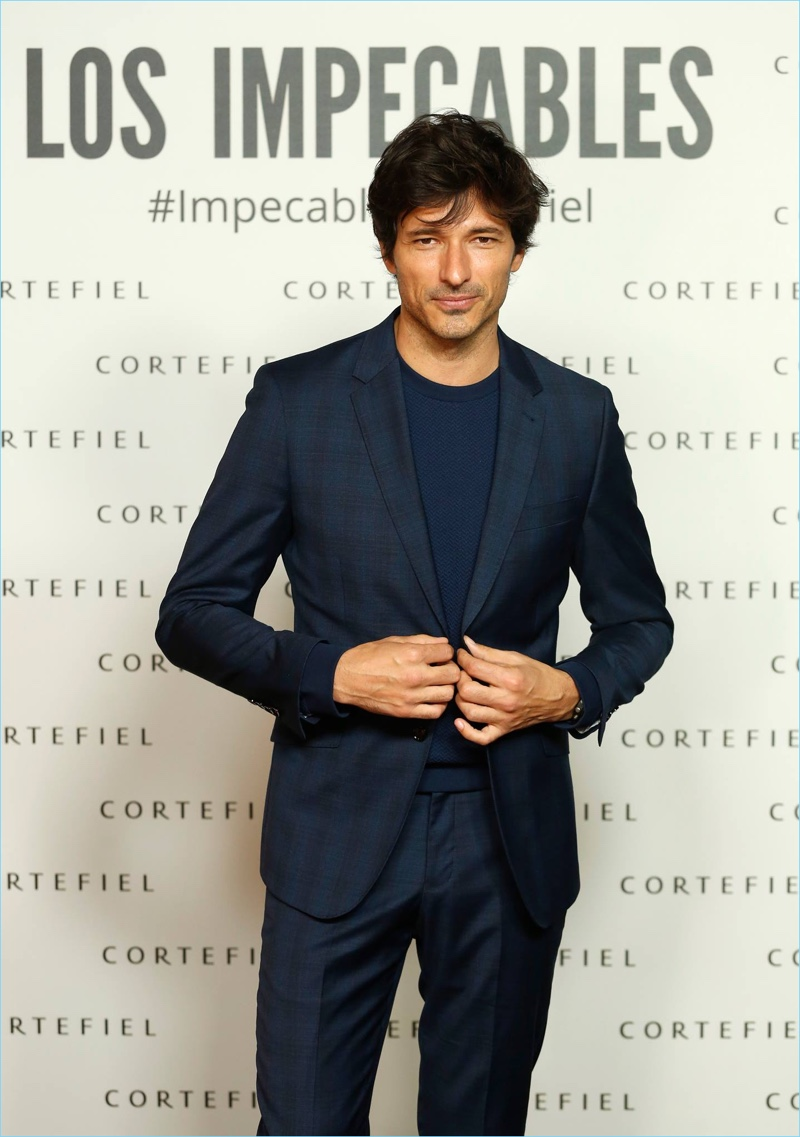 Promoting his new campaign with Cortefiel, Andres Velencoso hits the step and repeat.
