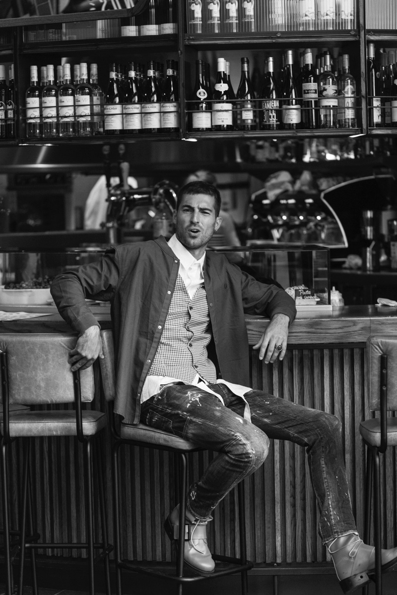 Antonio wears jacket Fred Perry, vest Galo Denim, shirt Llamazares y de Delgado, ring Galapagos, boots Dirk Bikkembergs, and jeans Dsquared2.