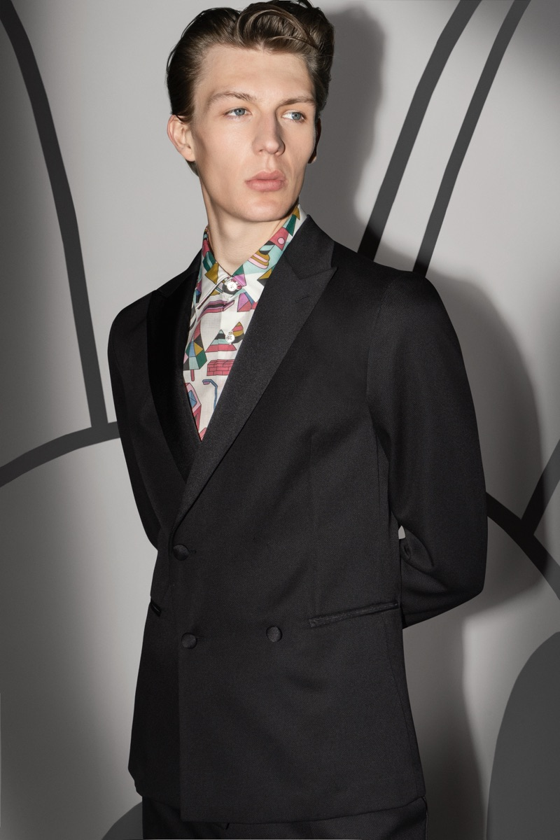 Finnlay Davis dons a sharp suit with a graphic shirt from the BOSS x Jeremyville holiday collection.
