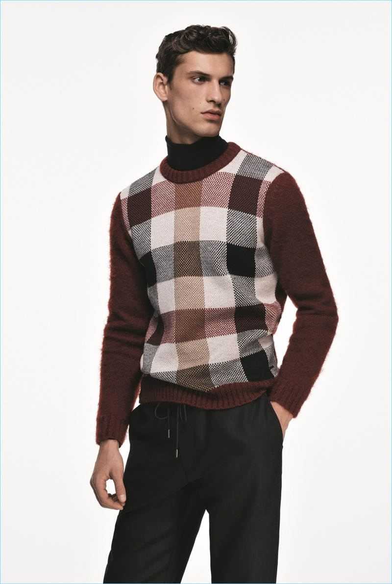 David Trulik models a check sweater from the BOSS Made in Germany capsule collection.