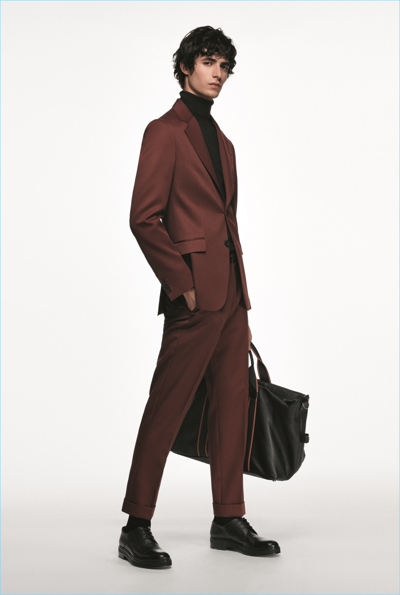 Oscar Kindelan dons a burgundy suit from the BOSS Made in Germany capsule collection.
