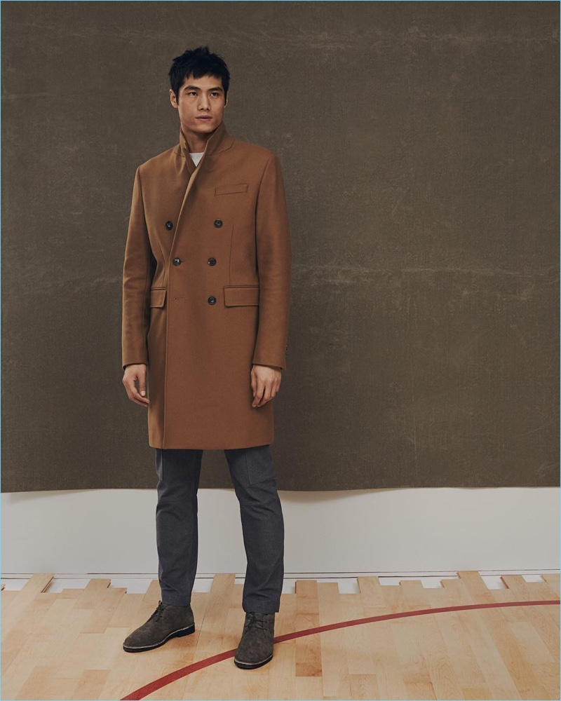 Hao Yun Xiang dons a Banana Republic x Kevin Love double-breasted coat and slim-fit Traveler pants.