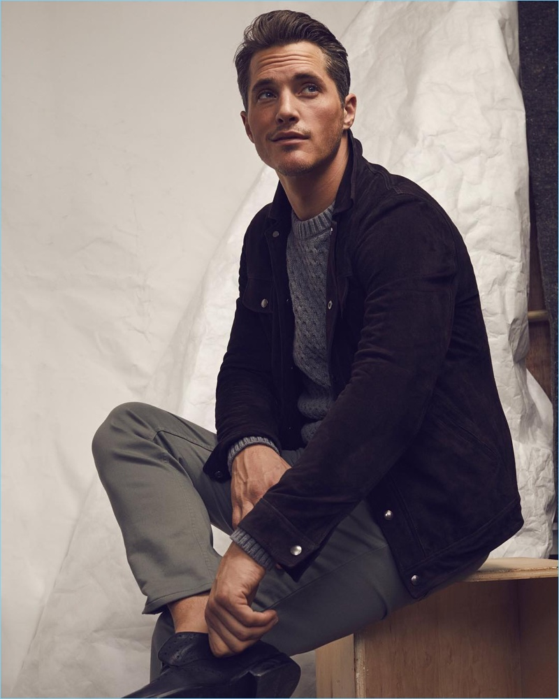 British model Ollie Edwards plays it smart in a Banana Republic Italian moleskin jacket, cable-knit sweater, and tapered traveler utility pants.
